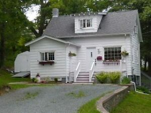 14-048 Charming little home on large country lot.