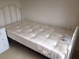 Single metal bed frame with Staples mattress