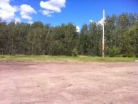 Fully serviced acreage for sale with shop/possible rent to own
