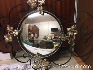 A Matching Pair of Black Wrought Iron Metal Oval Round Decorative Hanging Mirrors