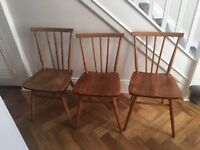 Three vintage original ercol beech and elm side chairs