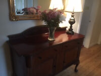 Antique sideboard with claw and ball feet
