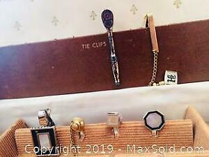Assorted tie clips and cuff links with case