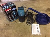 Submersible electrical powered pump, Makita PF 0410 with drainage hose