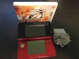 Nintendo 3DS, charger and Pokemon Sun game