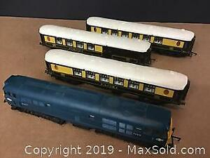 vintage Triang Train Engine and 3 passenger cars