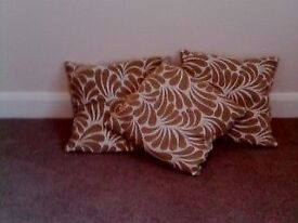 three patterned cushions unused condition,