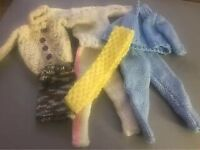 Small knitted dolls clothes
