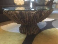 coffee table. Drift wood base with glass top.