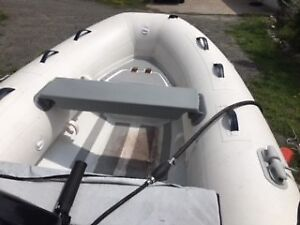2015 HIGHFIELD Dinghy with a 1995 SHORELANDER Trailer