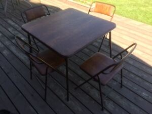 Padded card table and four folding chairs.
