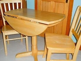 Solid wood (beech or birch) table and two chairs.