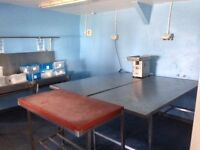 A meat cutting room with walk in chiller