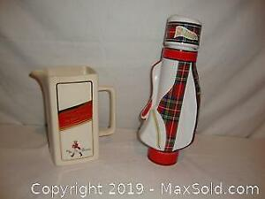 Johnnie Walker pitcher and empty McGibbons whisky bottle in shape of golf bag