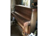 Upright Piano Reasonable condition ideal for learners