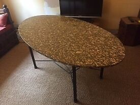 Oval Granite Table and Wrought Iron Chairs