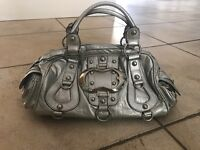 Silver 'Guess' ladies designer handbag with large 'G' silver buckle feature