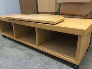 large TV stand on casters with centre turntable