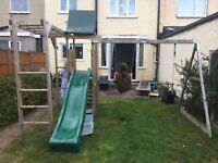 Wooden climbing frame, swing and slide