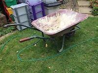 Wheelbarrow with damaged wheel bolt