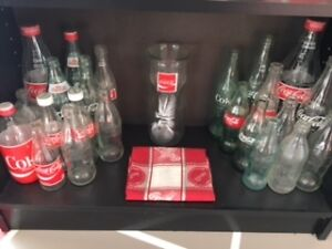 Coca Cola bottles and cans