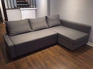 Corner sofa bed with storage, dark grey