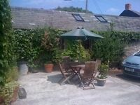 Devon - 2 bed barn conversion with parking and outside area but no garden. Oil fired central heating