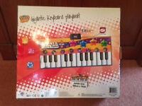 Gigantic Keyboard Playmat by ZIPPY MAT TOYS