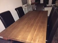 Attractive contemporary Solid light/medium Oak Dining Table and six brown faux leather chairs.