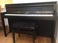 Yamaha Clavinova CLP 585 Digital Grand Piano as New. Adjustable piano stool included.