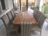 Reclaimed pine dining table seats 10 people