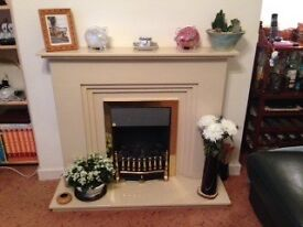 Marble fire surround and flickering effect coal electric fire.