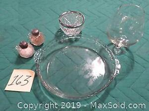 Glass pie plate, crystal salt and pepper, brandy snifter, chrome-rimmed dish