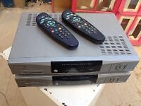 Two sky boxes and remotes