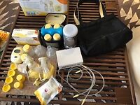 Medela freestyle electric double pump with all parts as boxed plus extras. Used twice. Why buy new?