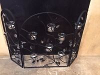 Ornamental fire place candle screen