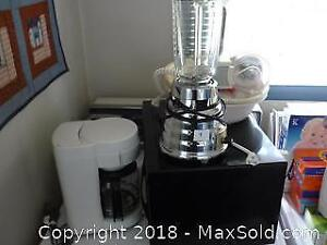 Lot of small appliances -Osterizer blender, coffee maker ect. -A