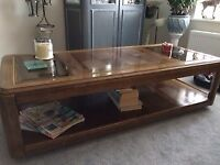 Beautiful crafted solid wood coffee table with two display sections either end of the top