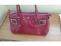 matching red JAG handbag and wallet