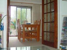 Lovely En suite double bedroom/Annex (ground floor) in a 4 Bedroom semi-detached house
