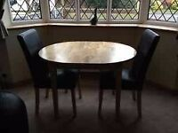 Extending table and 3x chairs