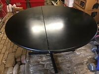 Black Ash Solid Round Table and Four Grey High Back Leather Chairs