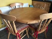 Round kitchen table and four chairs.