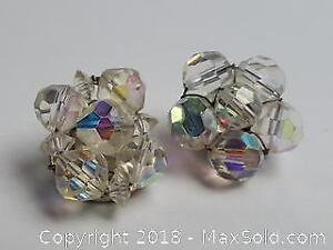 Vintage clip earrings with five crystals in a floral pattern