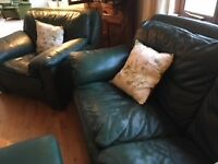 Three seater dark green sofa plus matching armchair and footstool