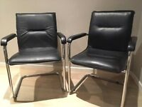 Pair of leather and chrome chairs for sale