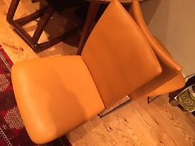 Orange dining chairs easy to clean