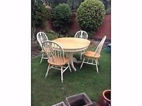 Round extending shabby chic kitchen table and four chairs