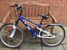 """Apollo Outrider Mountain Bike 26"""" with dirtbuster mudguard, 2 computers and lights, 6 gears."""