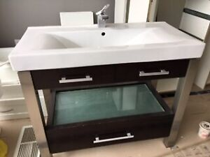 Bathroom sink and vanity with faucet